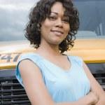 School Teacher In Front Of School Bus — Stock Photo