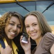 Friends Using Cell Phone By School Bus — Foto Stock