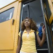 High School Girl Getting Off School Bus — Stock Photo