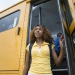 High School Girl Getting Off School Bus — Stock Photo