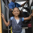Girl Getting Off School Bus — Foto de stock #21831917