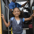 Girl Getting Off School Bus — Stock Photo