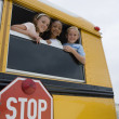 Stock Photo: Kids On A School Bus