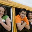 Students Looking Out Of School Bus Window — Stock Photo