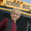 Boy Standing In Front Of School Bus — Lizenzfreies Foto