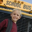 Boy Standing In Front Of School Bus — ストック写真