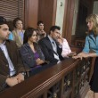 Female Attorney Addressing Jury - Stock Photo