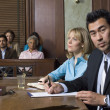 Stock Photo: Defense Lawyer With Client In Court