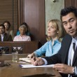 Defense Lawyer With Client In Court - Stock Photo