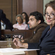 Foto de Stock  : Defense Lawyer With Client In Court