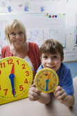 Little Boy Learning To Tell Time — Stock Photo