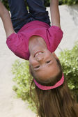 Little Girl Hanging Upside Down — Stock Photo