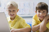 Schoolboys Using Laptop — Stock Photo