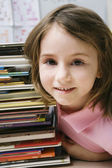 Little Girl With Stack Of Books — Stockfoto