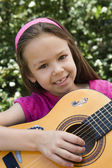 Little Girl Playing Guitar — Stock Photo