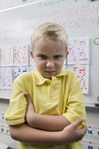 Angry Little Boy In Classroom — Stock Photo