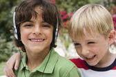 Boy Listening Music With Friend — Stock Photo