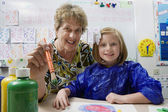 Teacher And Student Painting — Stock Photo
