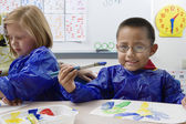 Elementary Students Painting — Stock Photo