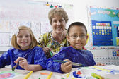 Teacher And Elementary Students — Stock Photo