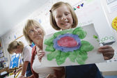 Elementary Student Showing Painting — Stock Photo