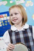 Elementary Student With Tambourine — Stock Photo