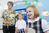 Elementary Student With Tambourine In Music Class — Stock Photo