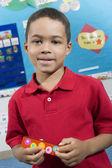 Elementaire student met mondharmonica — Stockfoto