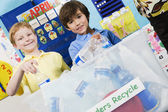Elementary Students With Recycling Container — Stock Photo
