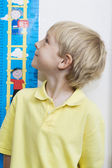 Boy Measuring Height In Classroom — Stock Photo