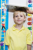 Boy Getting Height Measured By Teacher — Stock Photo