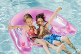 Friends Enjoying In Swimming Pool — Stock Photo