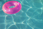 Pink Float Tube Floating On Water — Stockfoto