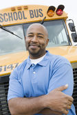 Teacher In Front Of School Bus — Stock Photo
