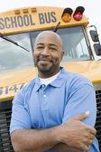 Teacher In Front Of School Bus — Stock Photo
