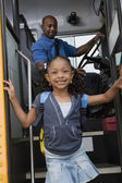 Girl Getting Off School Bus — Stockfoto