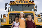 Students Standing In Front Of School Bus — Stock Photo