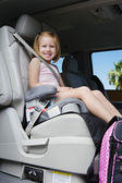 Girl Sitting In Booster Seat — Stock Photo
