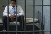 Businessman Sitting In Prison Cell — Stock Photo