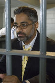 Man In Spectacles Behind Bars — Stock Photo