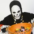 Boy Holding Bowl Of Candies In Halloween Outfit — Stock Photo #21866363