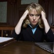 Female Lawyer Using Laptop In Courtroom — Stock Photo #21861643