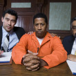 Criminal And Lawyers Sitting In Courtroom — Stock Photo #21861757
