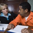 Female Lawyer With Criminal In Courtroom — Stock Photo