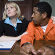 Female Lawyer With Criminal In Courtroom — Stock Photo #21861763