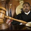 Gavel Lying In Front Of Judge — Stock Photo #21861945