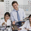 Stock Photo: Science Teacher Assisting Student