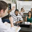 Stock Photo: Teacher Calling On Students In Science Class
