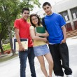 Teenage Friends Standing In Front Of School — Stock Photo