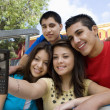 High School friends Taking Self Portrait With Cell Phone - Stockfoto